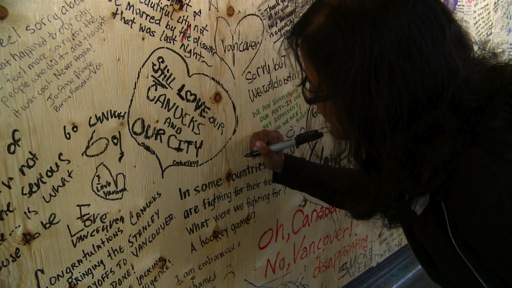 Kristy signing Wall of Hope