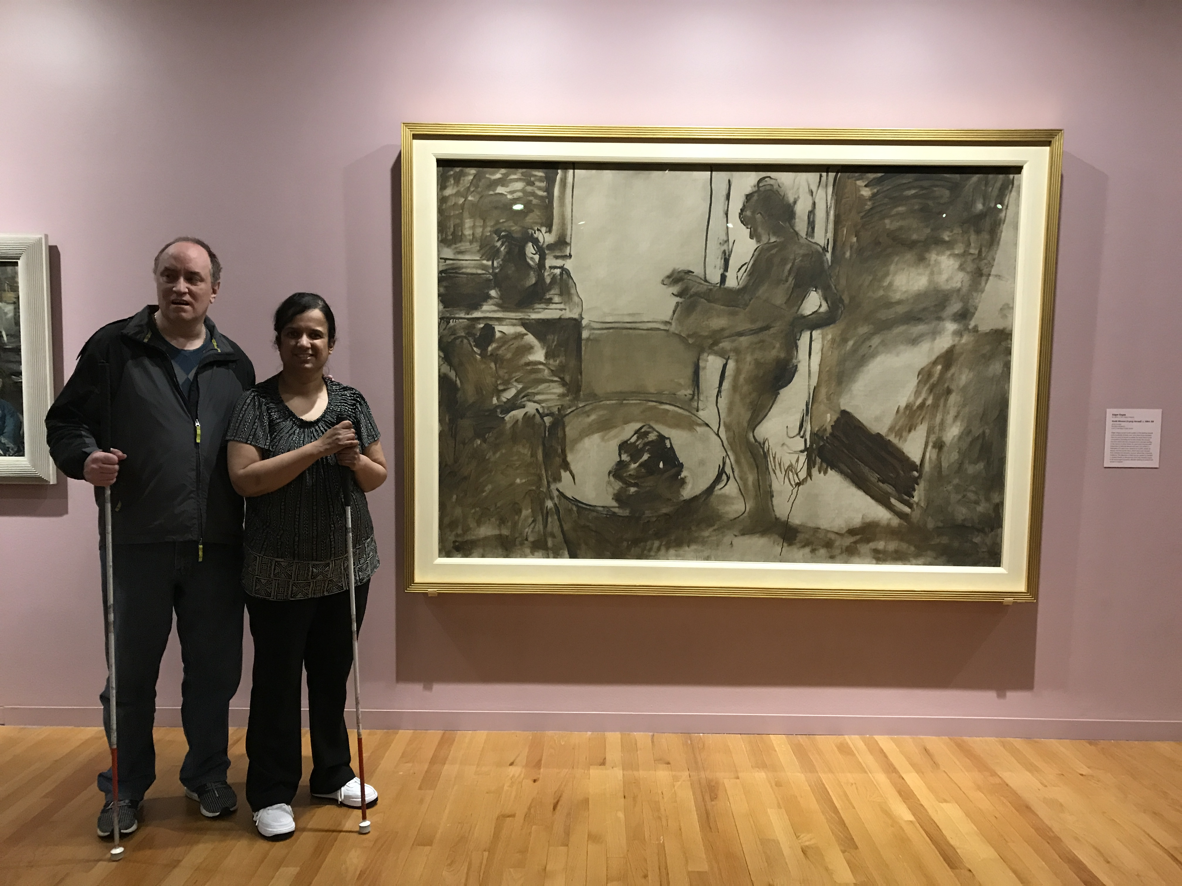 Kristy and Shawn beside one of the paintings by the French masters